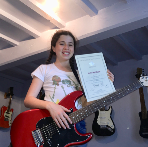 AJ G4 - guitar and bass lessons